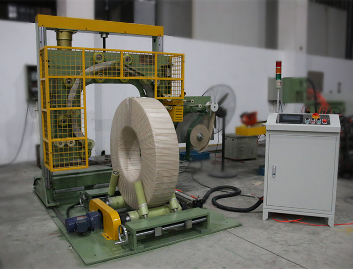 Vertical coil wrapping machine for coils package